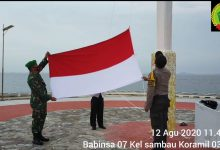 Photo of Babinsa 07 Koramil 03/Nongsa Kibarkan Bendera Merah Putih di Salah Satu Wilayah Perbatasan