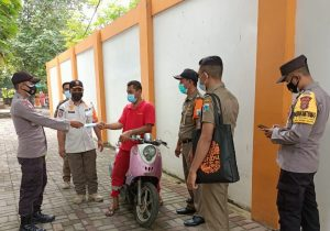 Cagah Covid-19, Polres Kepualuan Seribu Bagikan 1.600 Masker Medis Gratis