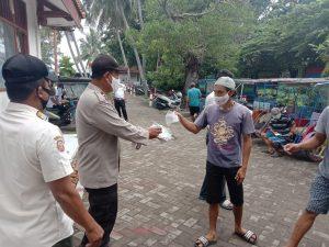 Wajibkan Masker, 1.600 Masker Medis dibagikan oleh Polres Kep Seribu